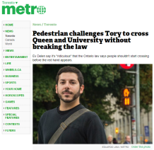 October 4, 2016 - Metro Toronto: Pedestrian challenges Tory to cross Queen and University without breaking the law